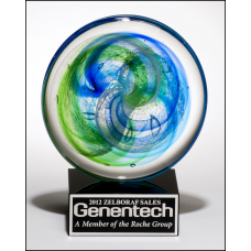 2107 Art glass disk with blue and light green accents on black glass base with felt bottom.