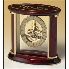 BC523 Skeleton clock with sub-second dial, brass finished movement and rosewood piano finish accents.