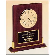 BC899 Desktop clock rosewood stained piano finish wood with gold metal accents.