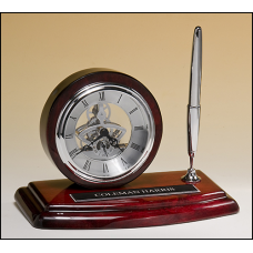 BC969 Skeleton clock, silver movement and pen with rosewood piano-finish case.