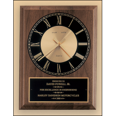 BC247 Small American walnut vertical wall clock with round face.