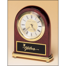 BC46 Rosewood stained piano finish Airflyte clock on a brass base.