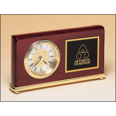 BC48 Rosewood stained piano finish Airflyte clock on a brass base.