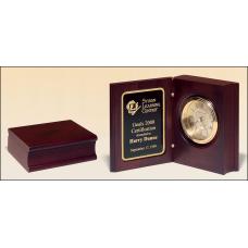 BC69 Hand-rubbed rich mahogany finish book clock, gold spun dial, three hand movement.