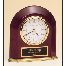 BC858 Rosewood stained piano finish arched table clock with solid brass base and three hand movement.