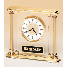 BC9 Airflyte clock with glass upright, brass feet and top and metal goldtone columns.