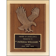 P1784 American walnut plaque with a sculptured relief eagle casting.