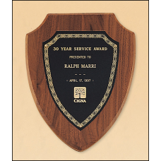 P34 American walnut plaque with a black brass plate.